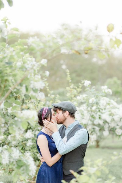 Hermann Park engagement photographer, couple kissing in flowers, springtime engagement session