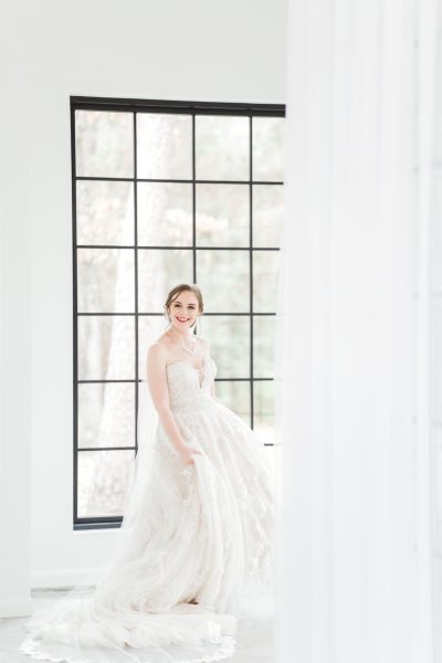 bride twirling in her dress, the oak atelier, springs event venues, springs woodlands weddings, houston wedding photographer