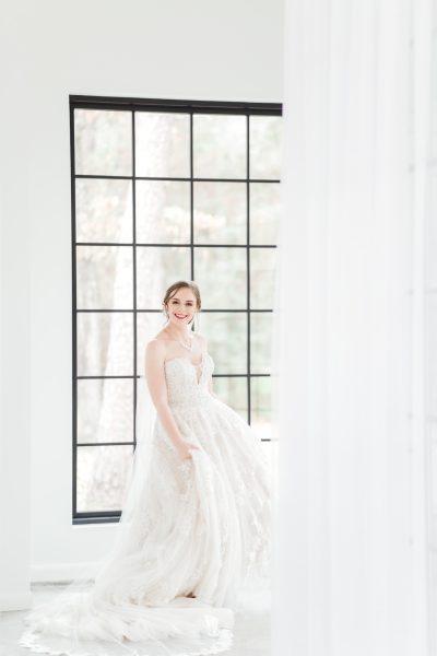bride twirling in her dress, the oak atelier, springs event venues, springs woodlands weddings, houston wedding photographer